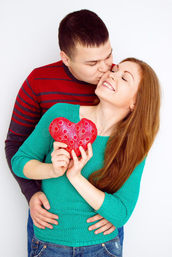 Valentine Couple. Portrait of Smiling Beauty Girl and her Handsome Boyfriend. Love Concept. Heart Sign. Happy Lovers. Valentines D. Valentine Couple. Portrait of stock image