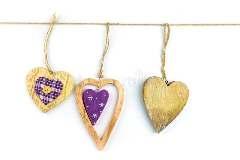 Decorative hearts on wood. . royalty free stock images