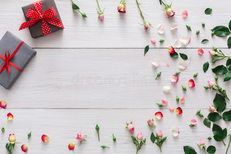 Valentine day background, gift boxes and flowers on white wood stock photos