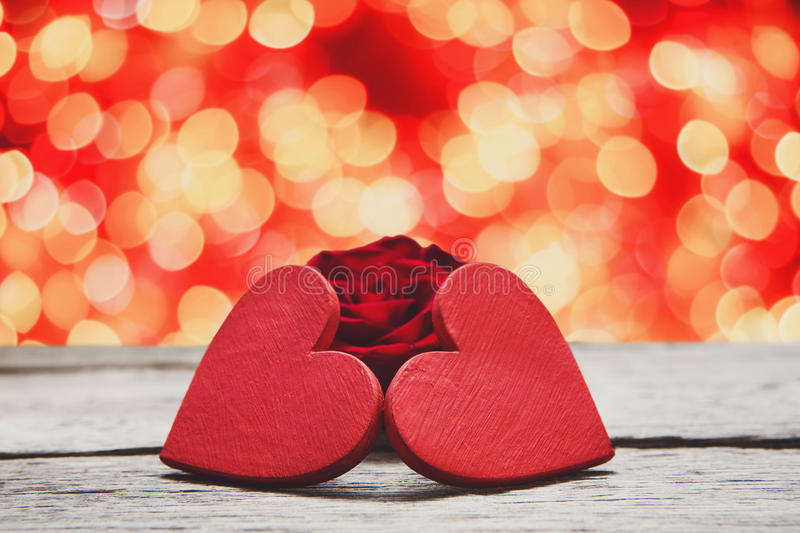 Valentine day background, handmade hearts on wood with holiday lights royalty free stock images