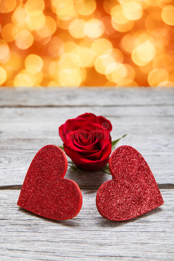 Valentine day background, handmade hearts on wood with holiday lights stock images