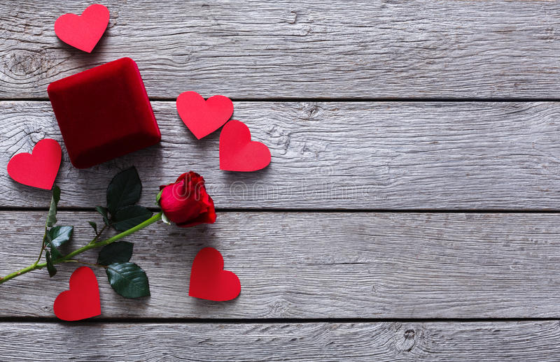 Valentine day background, jewelry box and rose flower on wood stock images