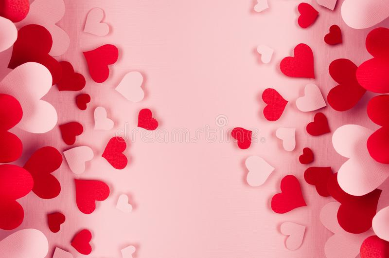 Valentine day background of many different paper hearts on pink soft background. Copy space. stock photos