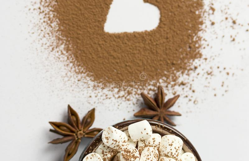 Valentine day background marshmellow, blue cup coffee cocoa powder star anis. Valentine day background marshmellow, blue cup coffee cocoa powder star anis royalty free stock photos