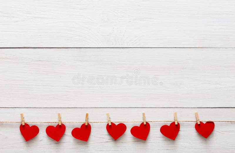 Valentine day background, paper hearts border on wood, copy space royalty free stock image