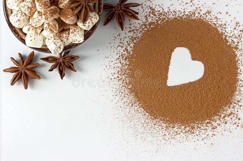 Valentine day backround marshmellow, blue cup coffee cocoa powder star anis. Valentine day backround marshmellow, blue cup coffee cocoa powder star anis stock photography