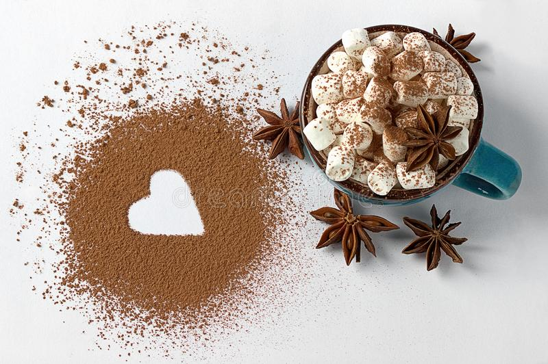 Valentine day backround marshmellow, blue cup coffee cocoa powder star anis. Valentine day backround marshmellow, blue cup coffee cocoa powder star anis royalty free stock photo