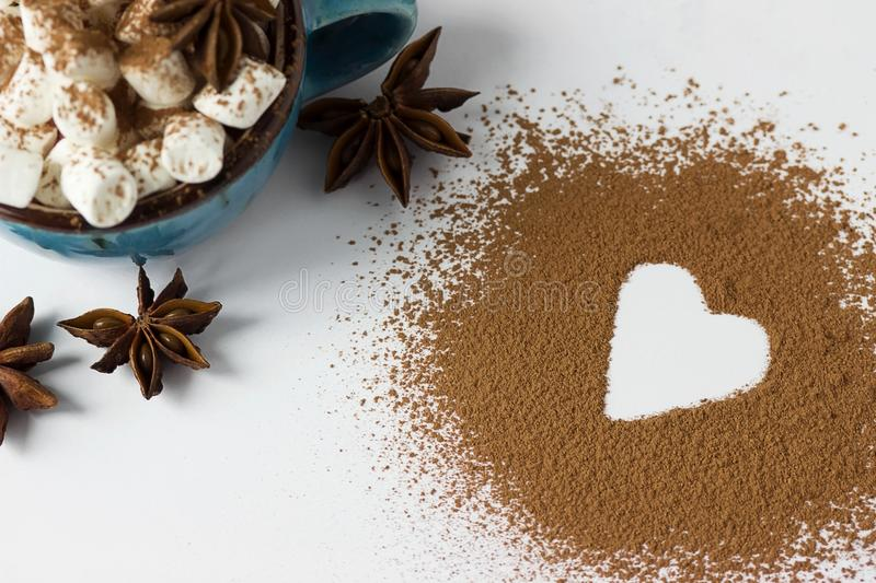 Valentine day backround marshmellow, blue cup coffee cocoa powder star anis. Valentine day backround marshmellow, blue cup coffee cocoa powder star anis stock images