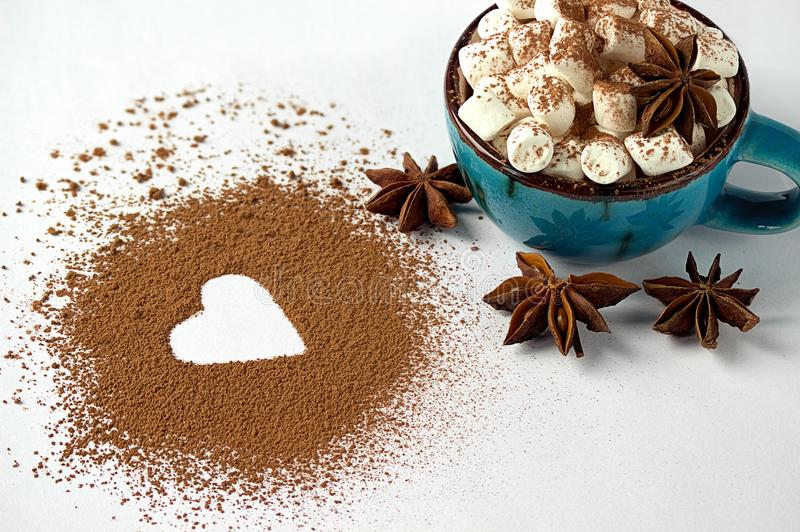 Valentine day backround marshmellow, blue cup coffee cocoa powder star anis. Valentine day backround marshmellow, blue cup coffee cocoa powder star anis stock photos