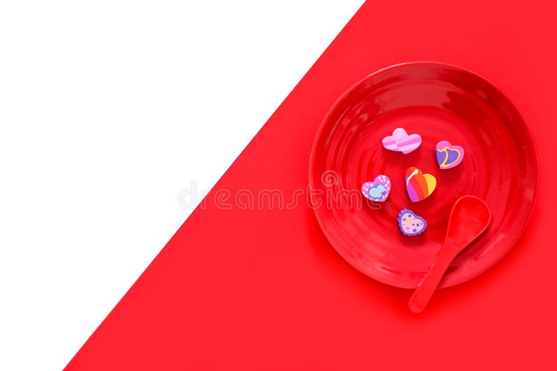 Valentine is Day Colorful Heart on a Red Plate and Spoon for Food Love Concept. Eraser in Shape of a Heart with Romantic on Two royalty free stock images
