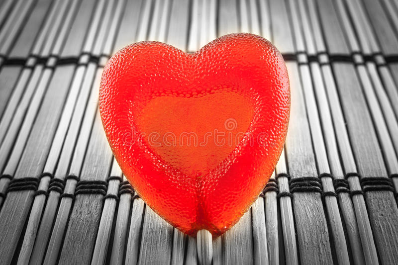 Valentine day concept - heart shaped lolly pop on wood background, copy space. Top image royalty free stock photo