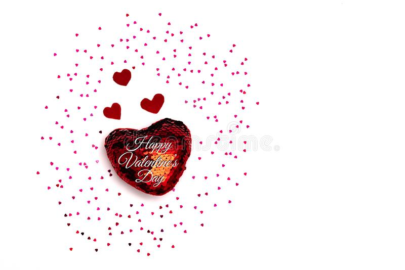 Valentine Day concept, white background with glitter red hearts stock photography