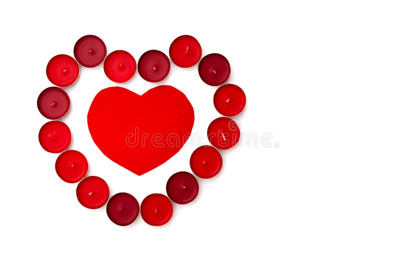 Valentine Day concept, white background with red hearts and candles royalty free stock photo
