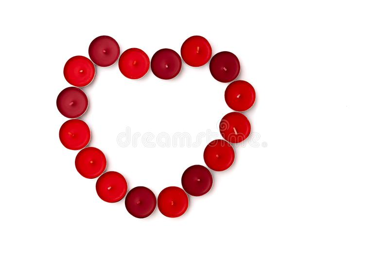 Valentine Day concept, white background with red hearts and candles stock photo