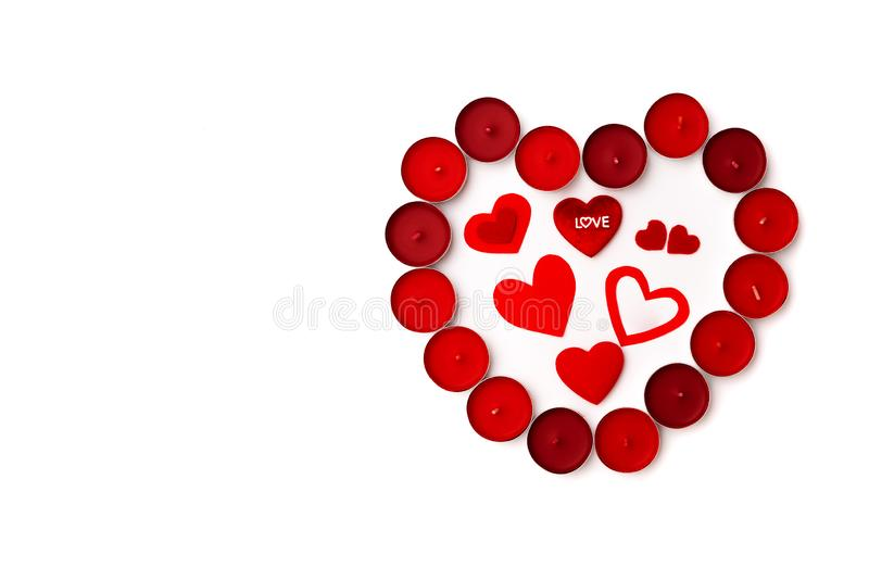 Valentine Day concept, white background with red hearts and candles stock photos