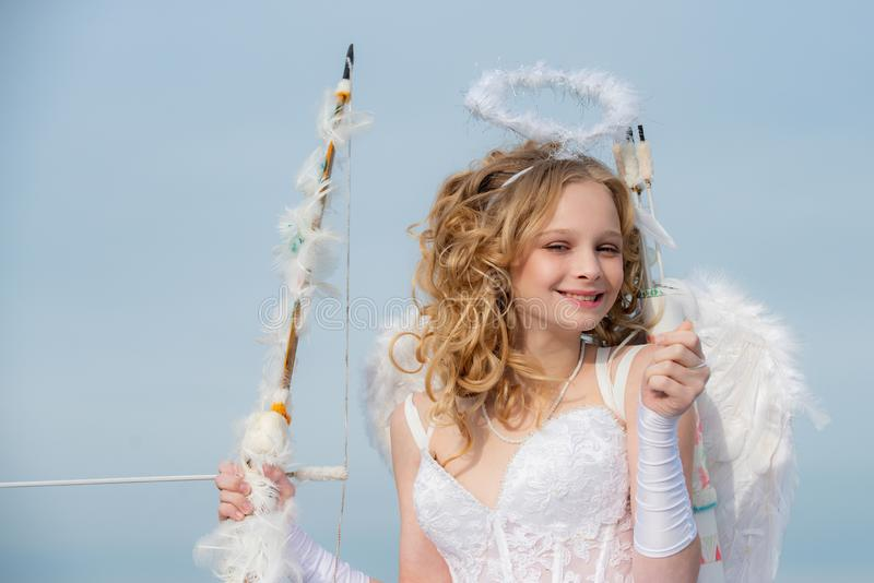 Valentine Day Gift Card - Holiday teen Cupid with Love. Innocent girl. Concept of Valentines Daygirl dressed as an angel. On a light background royalty free stock photography