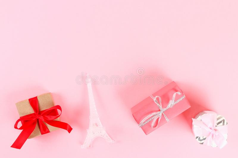 Valentine day layout. Gifts, hearts, Eiffel Tower on a pink pastel background. St. Valentines Day, day love, February 14 concept. royalty free stock images
