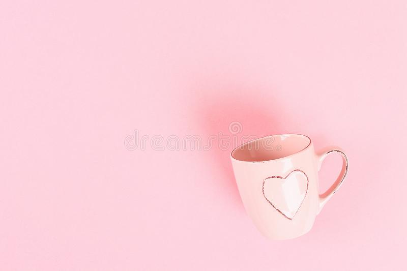 Valentine day layout. Mug with hearts on a pink pastel background. St. Valentines Day, day love, February 14 concept. Copy space,. Top view, flat lay stock images
