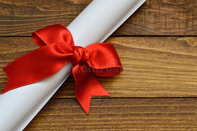 Valentine Day love letter. Tied with red ribbon stock photo