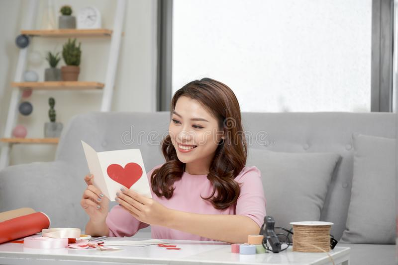 Valentine day theme. Beautiful romantic woman making present for her couple.  royalty free stock photo