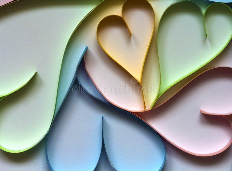 Valentine& x27; el fondo del extracto del día de s con colorido de papel cortada oye imagenes de archivo