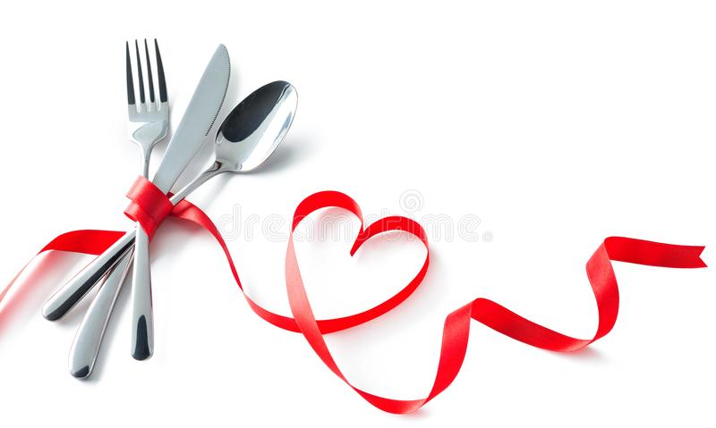Valentine fork, knife, spoon, silverware with red ribbon heart s royalty free stock images
