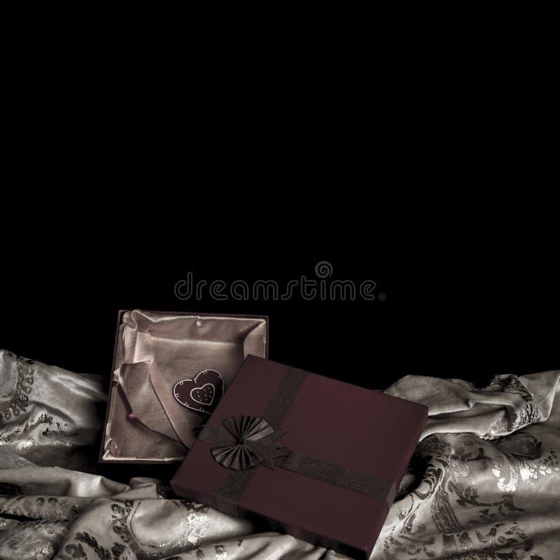 Valentine gift on black background royalty free stock photography