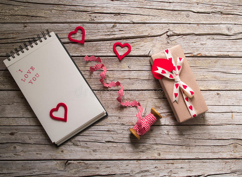 Valentine gift box, ribbon, notebook and heart shape tag on royalty free stock photos