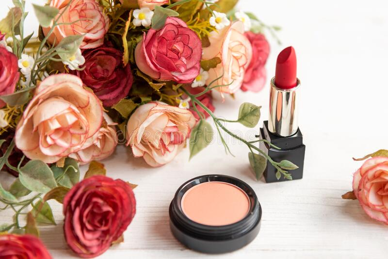 Valentine Gift. Makeup cosmetics tools background and beauty cosmetics, products and facial cosmetics package lipstick with flower stock photography