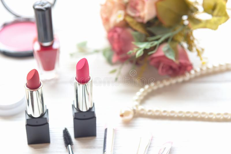 Valentine Gift. Makeup cosmetics tools background and beauty cosmetics, products and facial cosmetics package lipstick with pink r royalty free stock images