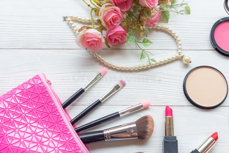 Valentine Gift. Makeup cosmetics tools background and beauty cosmetics, products and facial cosmetics package lipstick with pink r royalty free stock photography