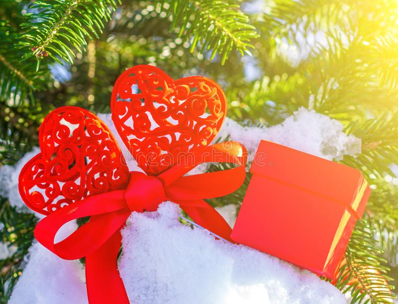 Valentine greeting card for Valentines day, Christmas or new year with two red hearts tied with a red ribbon and a red gift box royalty free stock photo