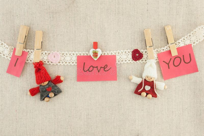 Valentine, greeting card. Wooden pins, red and pink hearts, knit royalty free stock photo