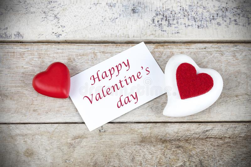 Valentine greeting card on wooden table with text Happy Valentine`s day. Valentine greeting card on wooden table with text Happy Valentine`s day royalty free stock image