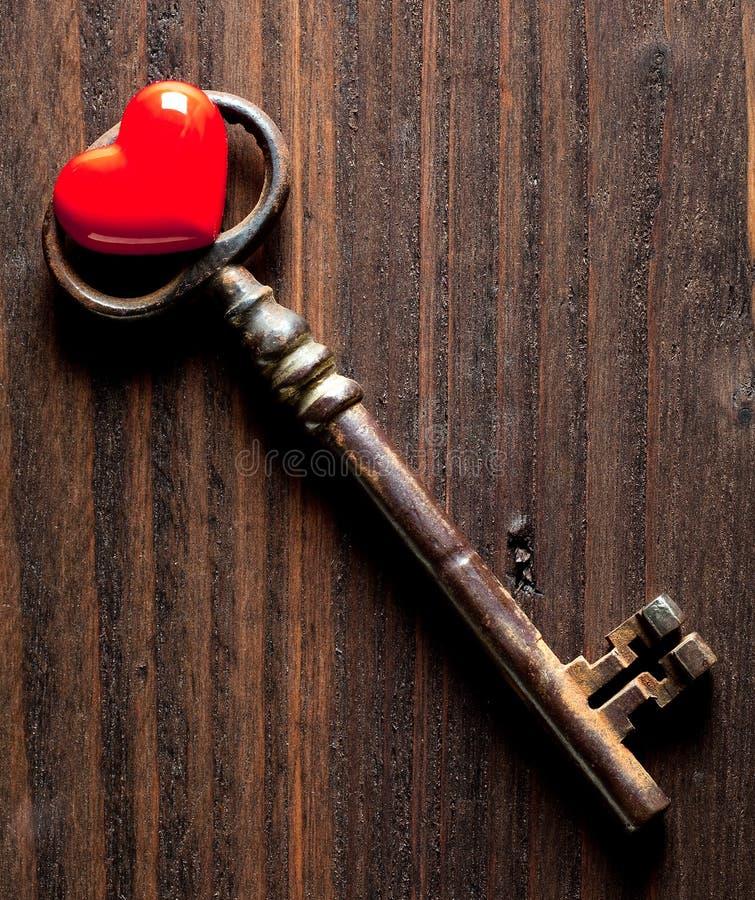 Valentine heart and rusty key royalty free stock photos
