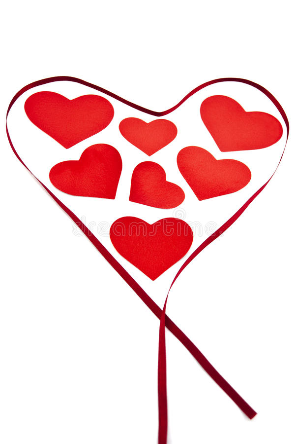 Valentine hearts surrounded by a ribbon. royalty free stock photography