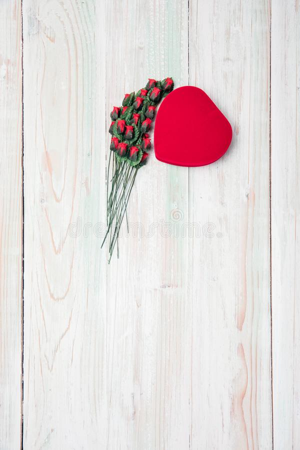Valentine love heart box  stack of rose  on wood royalty free stock image