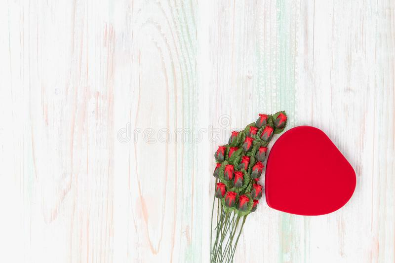 Valentine love heart box  stack of rose  on wood stock image