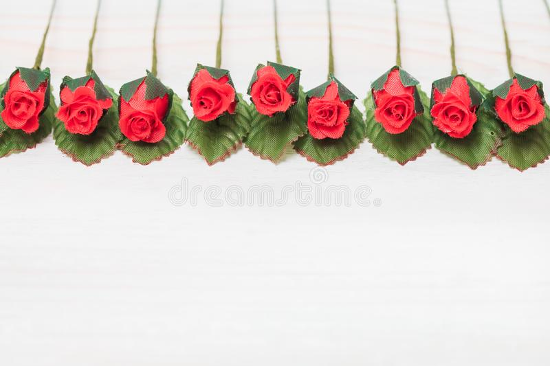 Valentine love heart orderly row of rose on wood royalty free stock images