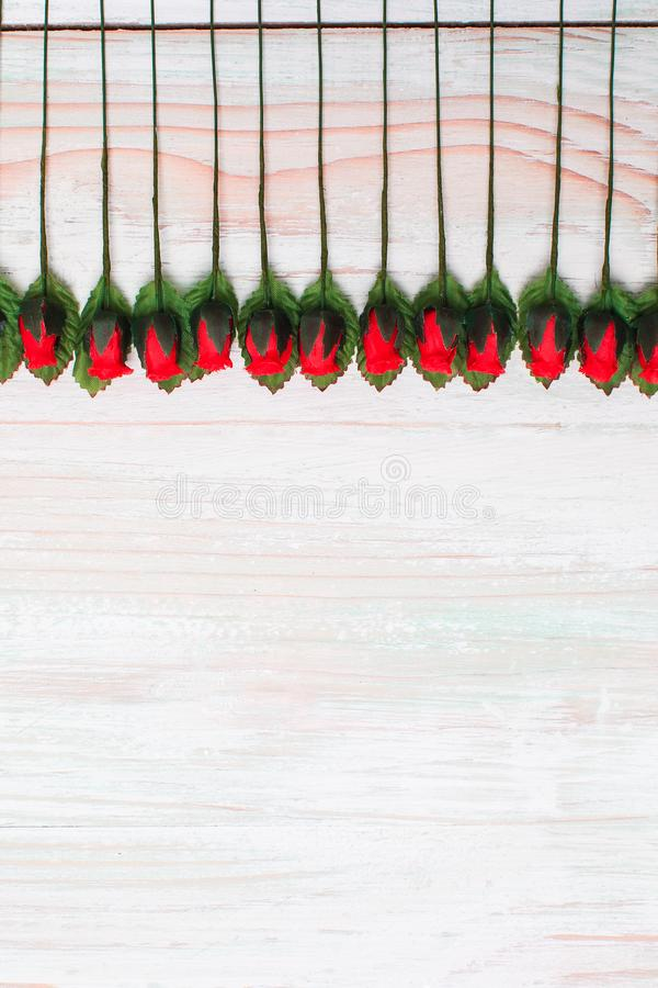 Valentine love heart orderly row of rose on wood stock photo