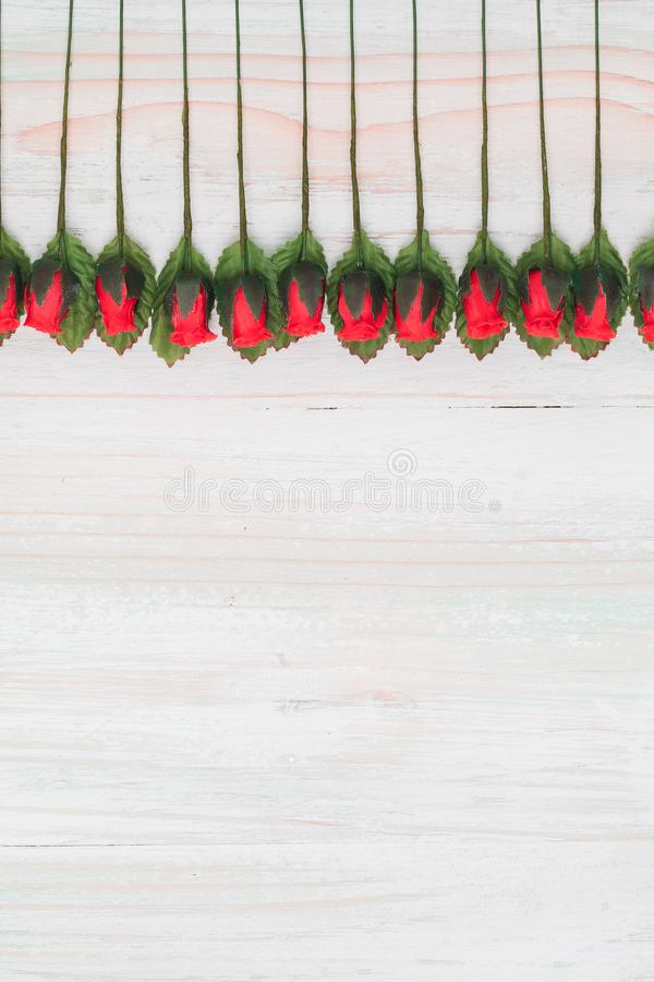 Valentine love heart orderly row of rose on wood royalty free stock image