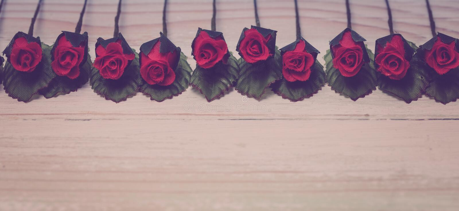 Valentine love heart orderly row of rose on wood royalty free stock photography