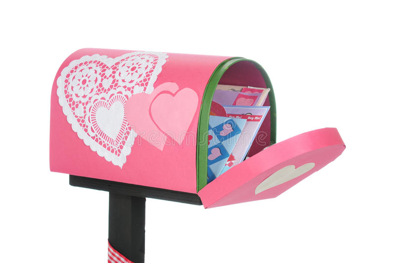 Valentine Mail. An opened valentine mailbox filled with loving cards. On a white background stock images