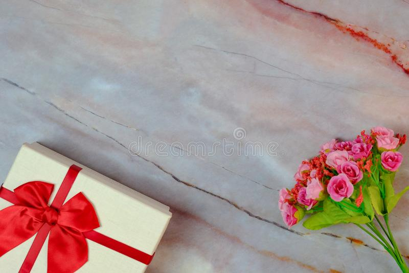 Valentine present. Gift box and red ribbon for romantic couple stock image