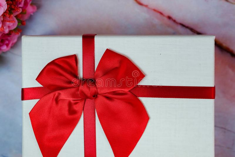 Valentine present. Gift box and red ribbon for romantic couple stock photography