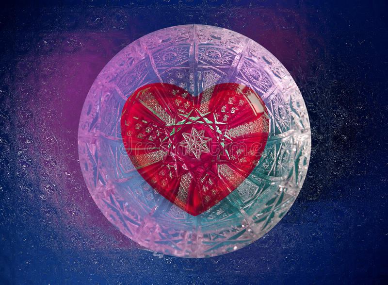 Valentine red heart in crystal glass ball. In comsos stock image