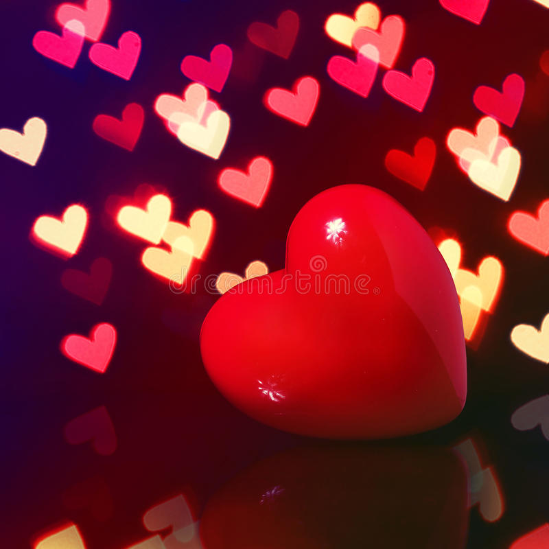 Valentine Red Heart over Bokeh in dark. Valentines Day Card royalty free stock image