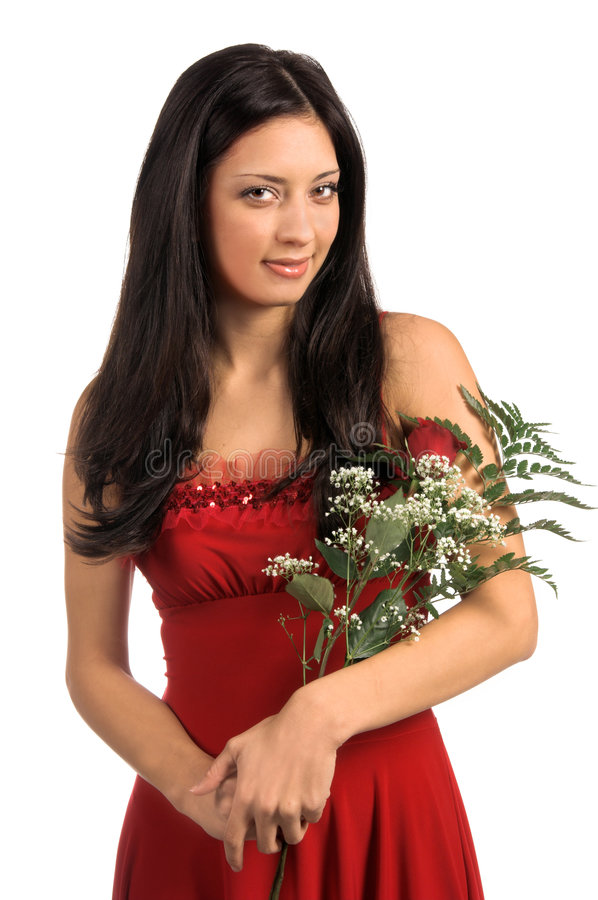 Valentine Rose. Beautiful latina woman in a red Valentine's Day dress with a red rose fern and baby's breath