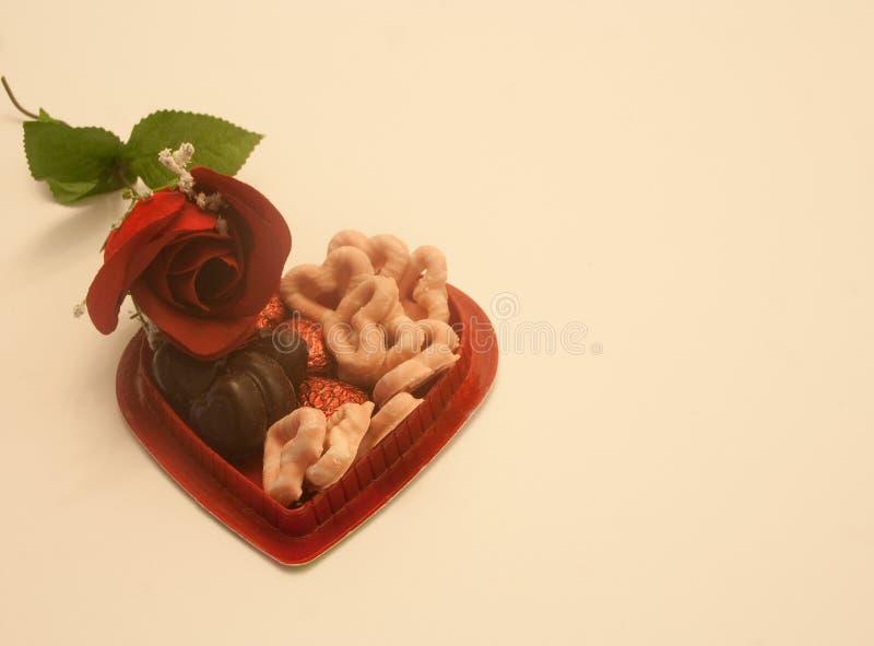 Valentine Rose, corazón y caramelos foto de archivo