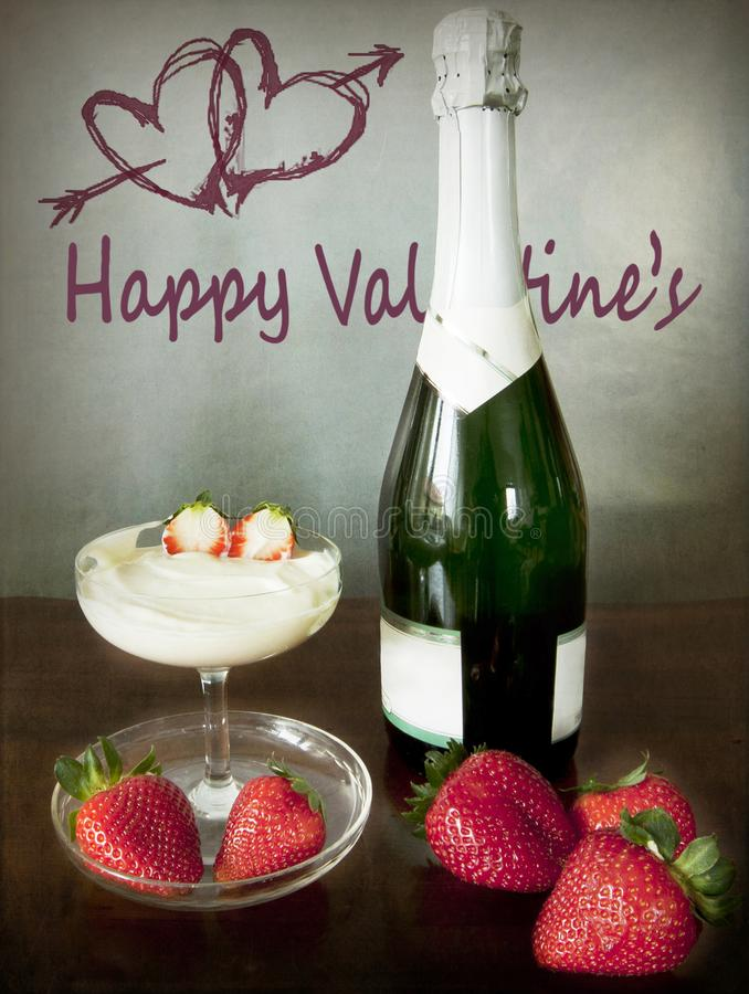 Valentine`s dating, champagne a cup of fresh cream and strawberries, two hearts with an arrow on the wall stock photo